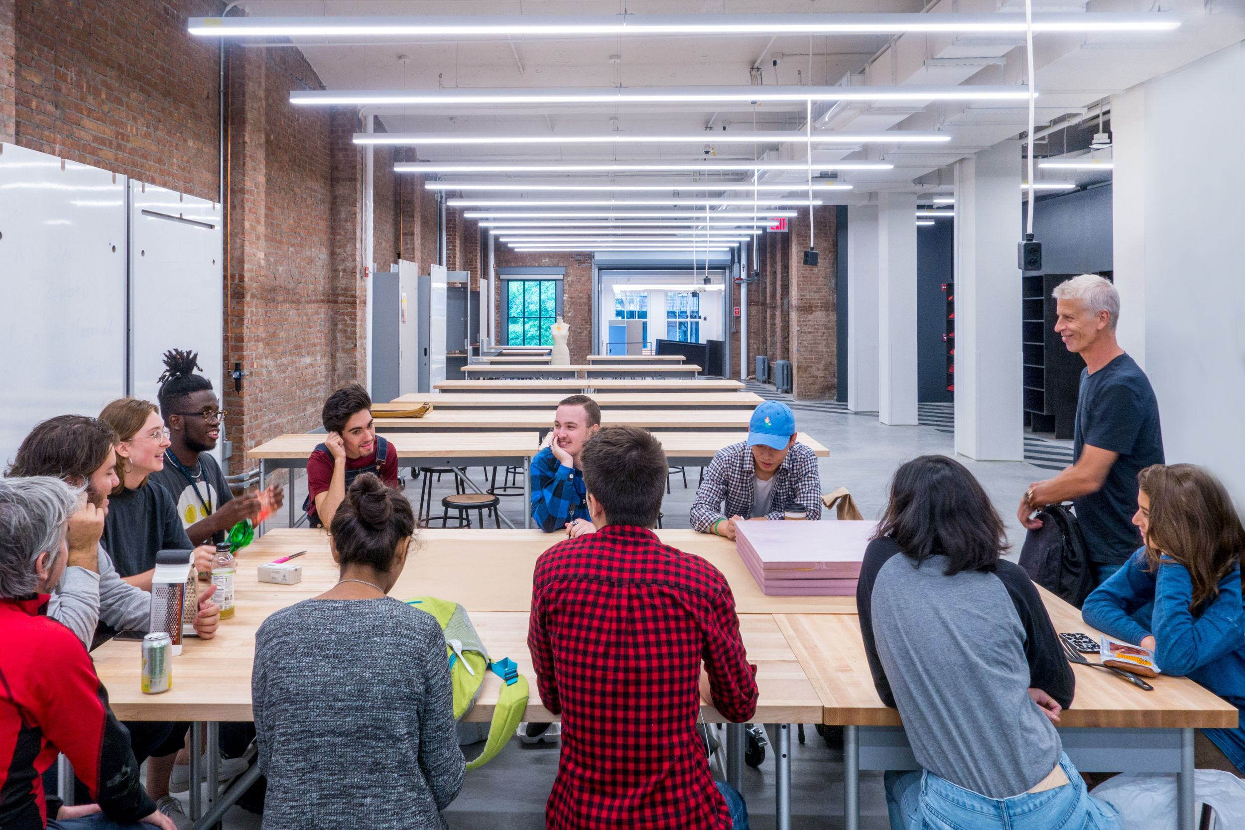 Parsons Making Center Butcher Block shop tables and large mobile storage partitions