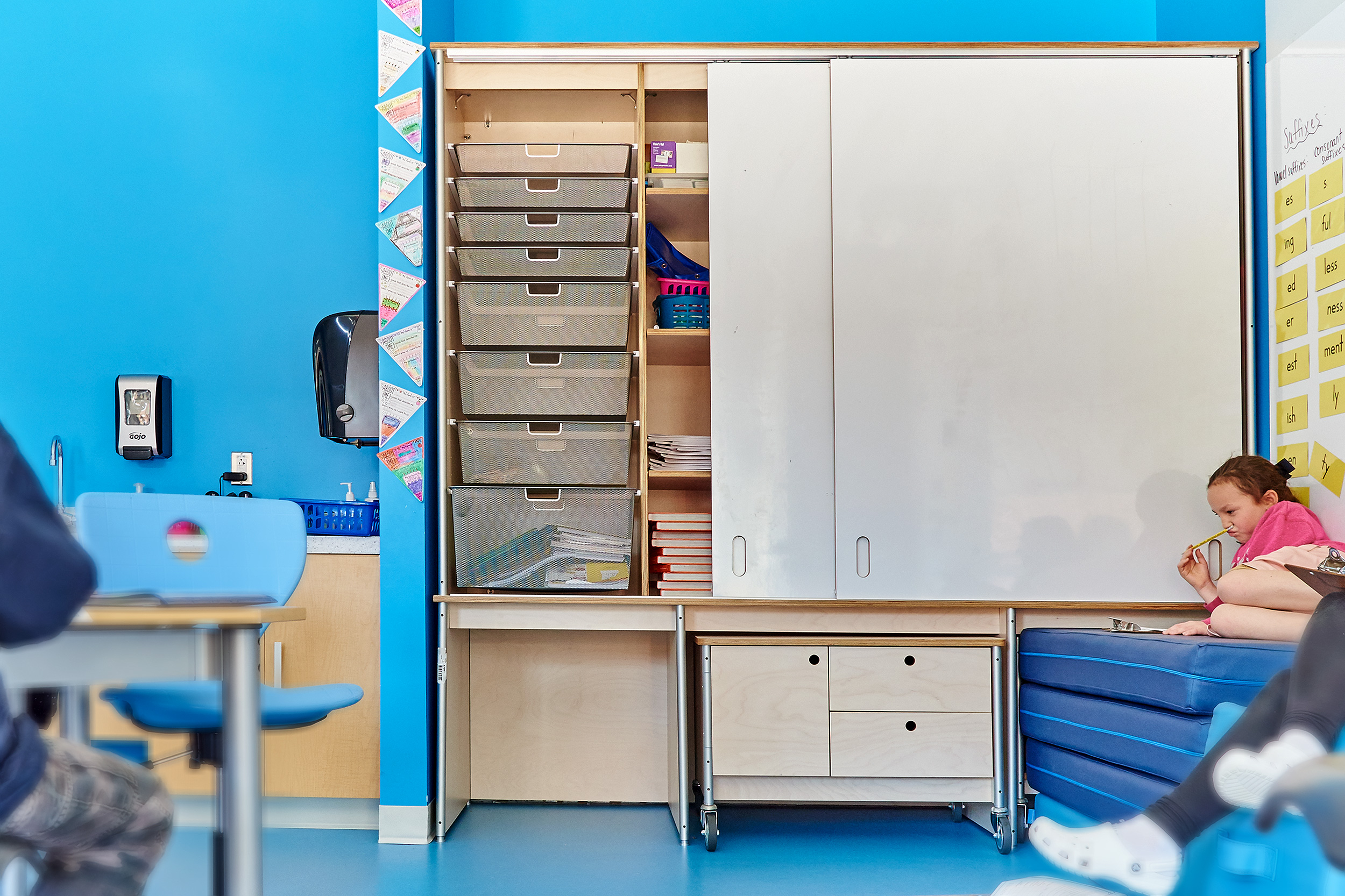 classroom wall storage with whiteboard baskets and cubbies